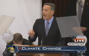 Phil Scott Trying Not To Be Seen during Shumlin's climate remarks. Screengrab from WCAX-TV.